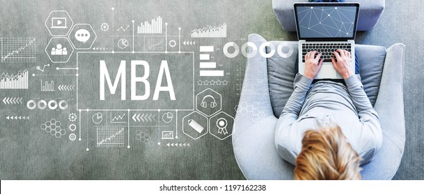 MBA with man using a laptop in a modern gray chair