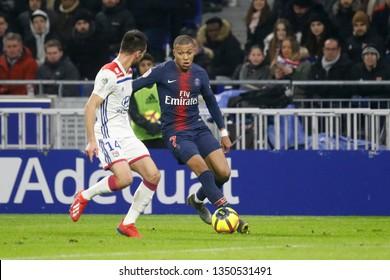 Mbappe Kylian of Paris and Dubois Leo of Lyon during French Championship Ligue 1 between Olympique Lyonnais and Paris Saint-Germain 2/3/2019 Groupama stadium Decines-Charpieu Lyon, France