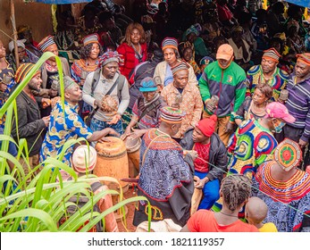 Mbouda, West/Cameroon - 22/09/2020: Group of people wearing traditionals clothes dancing around tamtam drummers during a funeral ceremony in the west region of Cameroon.