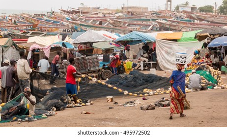 Mbour, Senegal - July, 2014: Fishermen set up their nets to go back to the see at the local fish market in Mbour on July 9, 2014 in Mbour, Senegal.