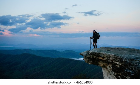 MCAFEE KNOB, VIRGINIA - MAY 29, 2015 - An Appalachian Trail Thru-Hiker stands atop McAfee Knob at sunset in central Virginia, about 700 miles into his 2189 mile journey north to Maine.