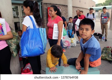 McAllen, Tx/U.S. - April 17, 2019: A young Central American boy migrant who, with his family, is seeking asylum from poverty and gang violence, waits to board a bus to his Immigration hearing sponsor.