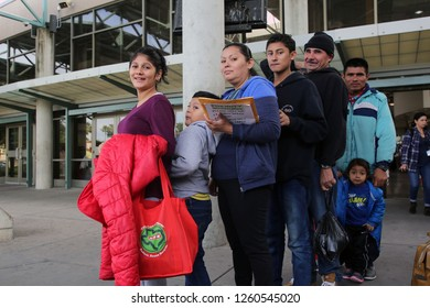 McAllen, Tx/U.S. - Dec. 12, 2018:  A small group of Central American migrants fleeing poverty and gang violence wait to board a bus to their sponsors where they will wait for their asylum hearings.