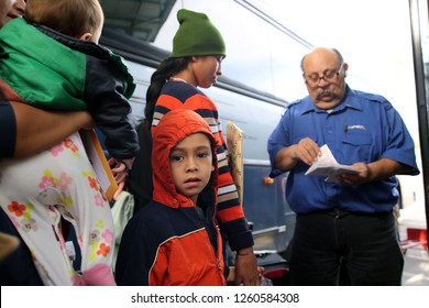 McAllen, Tx/U.S. - Dec. 12, 2018:  A young Central American boy who entered the U.S. illegally boards a bus with his mother to go to their sponsor where they'll wait for an asylum hearing.