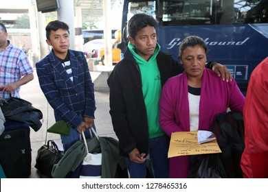 McAllen, Tx/U.S. - Dec. 12, 2018:  A Guatemalan family who entered the U.S. illegally by crossing the Rio Grande River wait to board a bus to their sponsor to wait for an asylum hearing.