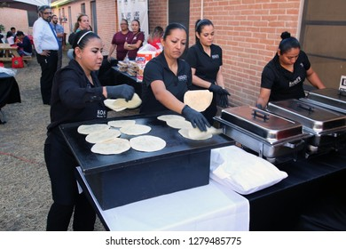 McAllen, TX/U.S. - Dec. 12, 2018: Volunteers with the Catholic Charities' Humanitarian Respite Center make tortillas for a dinner for Central American migrants celebrating the Virgen of Guadalupe.