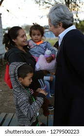 McAllen, TX/U.S. - Dec. 12, 2018: Sister Norma Pimental, director of the Catholic Charities' Humanitarian Respite Center, speaks with a young Central American woman seeking asylum and her family.
