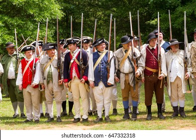MCCONNELLS, SC - May 20, 2017:  Revolutionary War reenactors representing American Patriots muster at Historic Brattonsville, a colonial living history museum.