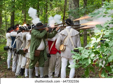 MCCONNELLS, SC - May 20, 2017:  Revolutionary War reenactors representing American Patriots recreate the Battle of Kings Mountain at Historic Brattonsville, a colonial living history museum.