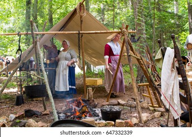 MCCONNELLS, SC - May 20, 2017:  Revolutionary War reenactors recreate a colonial military camp at Historic Brattonsville, a colonial living history museum.