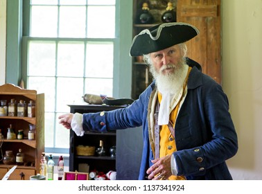 MCCONNELLS, SC (USA) - July 14, 2018:  A reenactor in Colonial period costume welcomes visitors to Historic Brattonsville, a living history museum.