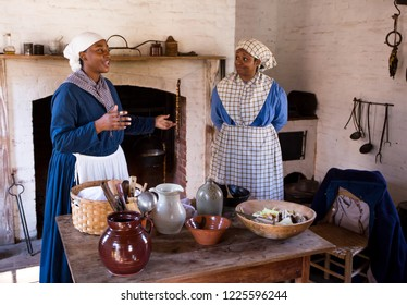 MCCONNELLS, SC (USA) - November 3, 2018:  Reenactors in period dress describe the lives of enslaved people during an American Civil War reenactment at Historic Brattonsville, a living history museum.