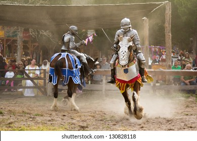 MCDADE, TX -  FEBRUARY 24: A jousting tournament between two knights at The Sherwood Forest Faire on February 24, 2013 in McDade, Texas.
