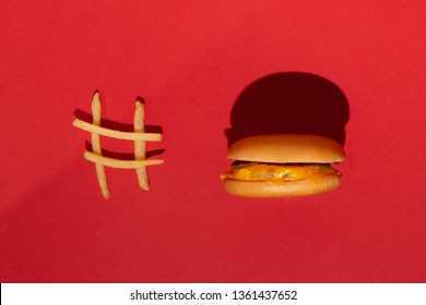 McDonald's menu: French fries and burger on red background. Minimal concept