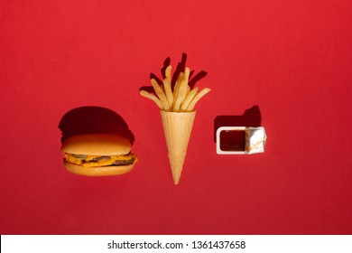 McDonald's menu: French fries in a cup and burger on red background. Minimal concept