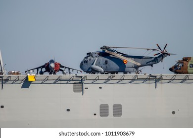 """McDonnell Douglas AV-8B Harrier II and Helicopter Sikorsky SH-3 Sea King in deck of Spanish Navy aircraft carrier """"Juan Carlos I"""" moored in south port of Huelva"""