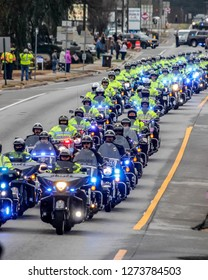 McDonough, GA / USA - January 3, 2019: Law enforcement officers from several agencies on motorcycles lead the hearse carrying the body of Officer Michael Smith of the Henry County Police Department.