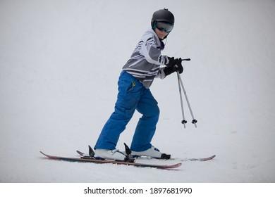 MCHENRY, MD, UNITED STATES - Feb 24, 2013: A junior snow skier on the ski slope at the Wisp Ski Resort in McHenry, Maryland