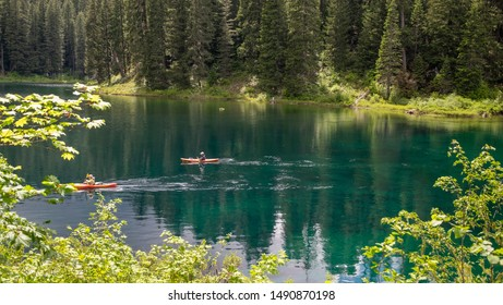 McKenzie river, Oregon, usa - June, 11th, 2017: couple of red kayak paddle in the blue waters