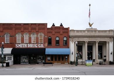 McKinney, Texas / USA - April 5, 2020: First National Bank building and Smith Drug Company