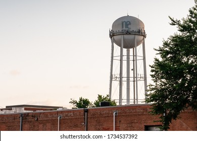 McKinney, Texas/United States - May 12, 2020: Sunset view of a McKinney, Texas water tower taken from the growing Historic Downtown McKinney Cultural District.