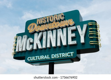 McKinney, Texas/United States - May 15, 2020: Neon Historic Downtown McKinney Cultural District parking lot sign on a pole in McKinney, Texas.
