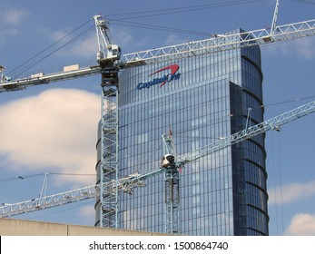 McLean, Va./USA-9/10/19: Construction cranes frame Capital One Bank's glass and steel headquarters building outside Washington, D.C.