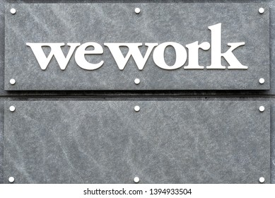 MCLEAN, VIRGINIA / USA - 11 MAY 2019:  A sign for the WeWork site in Tysons Corner. WeWork is a company that provides shared collaborative workspaces for startups, freelancers, and small businesses.