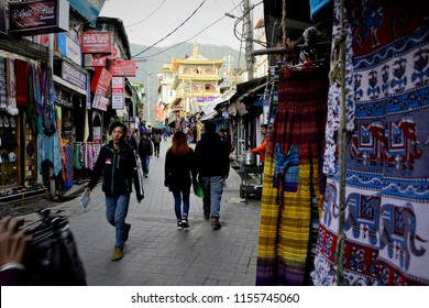Mcleodganj, Himachal Pradesh - December 13 2016 : People strolling on the streets of Mcleodganj market on a cloudy day.