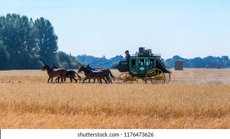 McMinnville, Oregon - August 18, 2018:  A vintage Old West stagecoach ran across the hay field at the Harvest Fest held at the Yamhill Valley Heritage Center.
