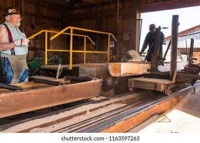 McMinnville, Oregon - August 18, 2018Old Vintage Sawmill with Large Spinning Saw and Raw Lumber being cut and Sawdust flying.