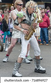 McMinnville, Oregon, USA - May 16, 2015: Portland's Marching Band, LoveBomb Go-Go, puts on a show at the Annual UFO Fest.  A saxophone player plays for crowd