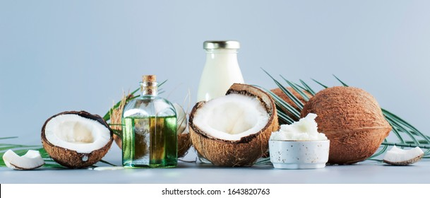 MCT Coconut butter or coconut oil. Organic healthy food, beauty and SPA concept. Blue banner background. Copy space
