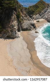 McWay Falls in McWay Creek. Beautiful pacific sand beach with waterfall along the Big Sur coast, California.This tidefall is located in the Julia Pfeiffer Burns State Park, California.