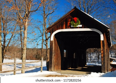 The McWilliams Bridge, a historic covered bridge in Grafton, Vermont, is decorated for the Christmas season