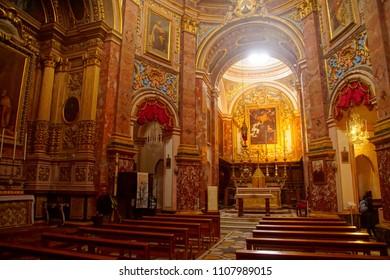 MDINA, MALTA - APR 19, 2018 - Golden altar of the Carmelite priory in the medieval city of Mdina, Malta