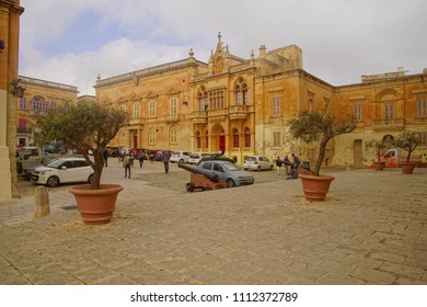 MDINA, MALTA - APR 19, 2018 - Plaza and exterior of the Cathedral Treasury museum and St Paul's Cathedral, Mdina, Malta
