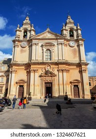 Mdina, Malta - February 22, 2019: Tourists near St Paul's Cathedral