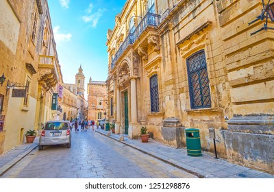 MDINA, MALTA - JUNE 14, 2018: Walk along streets in Mdina fortress anf enjoy magnificent medieval architecture of surrounding edifices, on June 14 in Mdina.
