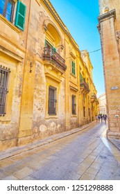MDINA, MALTA - JUNE 14, 2018: The medieval edifice of Mdina fortress stretch along narrow streets, on June 14 in Mdina.