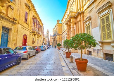 MDINA, MALTA - JUNE 14, 2018: The wide medieval street in Mdina fortress with beautiful decorated edifices, stretch along it, on June 14 in Mdina