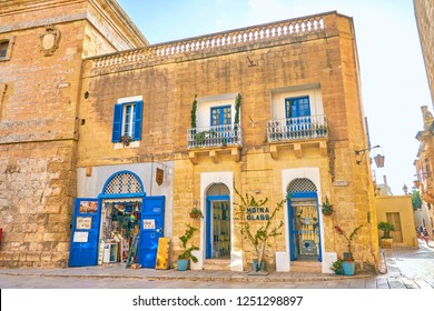 MDINA, MALTA - JUNE 14, 2018: The historical edifice in Mdina fortress with  souvenir and glass shops on the ground floor, on June 14 in Mdina.