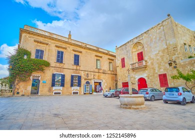 MDINA, MALTA - JUNE 14, 2018: The empty evening street with souvenir shop in historical edifice, in the heart of Mdina fortress, on June 14 in Mdina.