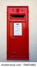 MDINA, MALTA - MARCH 29, 2017 - Traditional red British postbox in a wall, Mdina, Malta, Europe, March 29, 2017.