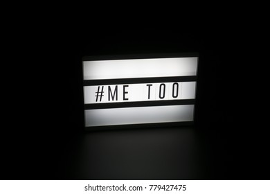 Me Too text in a light box. Hashtag me too. #metoo Dark, isolated background. A sign with a message