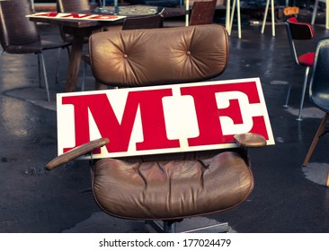 """""""Me"""" written in red on a big white board on an office chair in a market in London (UK)"""