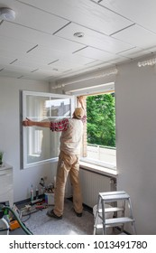meachanic adjusting a new window after replacement