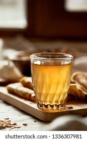 Mead and pancakes. Russian dish for Shrove Tuesday. Farewell to winter, Close a glass with a glowing drink.