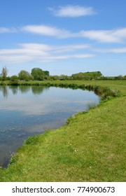 Meadow with River in the Cotswolds, England during early Summer