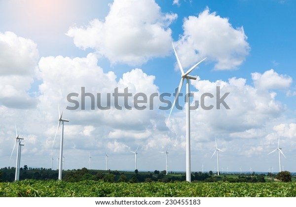 meadow with wind turbines generating electricity